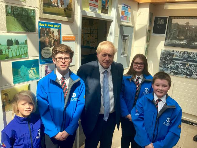 VISIT: Conservative leadership candidate Boris Johnson with pupils from the Jill Dando News Centre at The King Alfred School