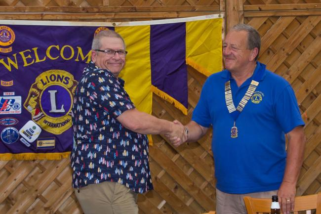 NEW PRESIDENT: Outgoing president of Burnham-on-Sea Lions Doug Plume hands over the reigns to new president Phil Cooke