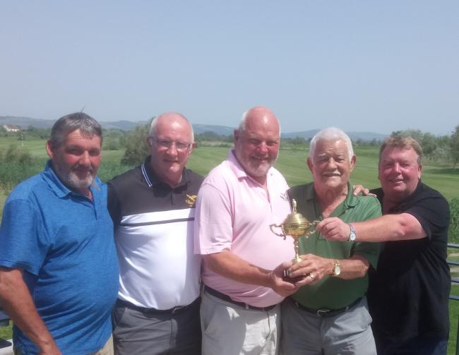 TROPHY: Boom Boom Cup winners (from left): Dave Mann, Stewart Garrett, Mike Porter (presenting trophy), Tony Groves and Paul Bacon
