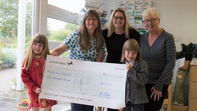 FUNDRAISING: Lucy and Bella Redding with Janet Perks and staff from Weston Hospicecare