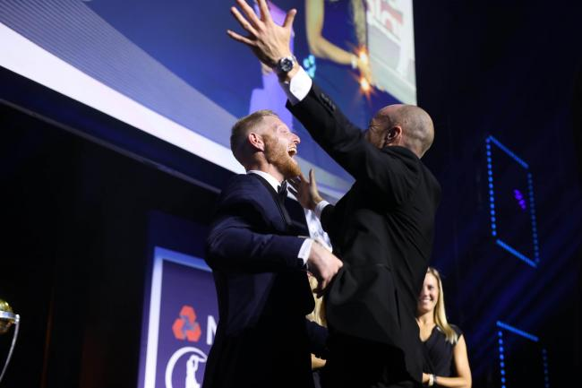Jack Leach embraces Ben Stokes after buying a signed painting of the England star at the PCA Awards
