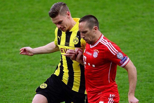 Borussia Dortmund's Lukasz Piszczek, left, and former Bayern Munich winger Franck Ribery during a previous 'Der Klassiker'