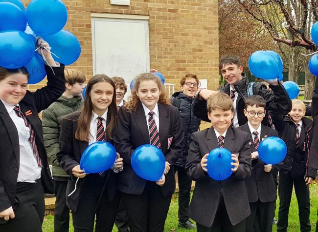 KINDNESS: Students at The King Alfred School with their blue balloons to mark their random acts of kindness