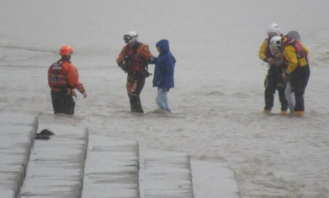 RESCUE: The two women and their dog were walked to safety