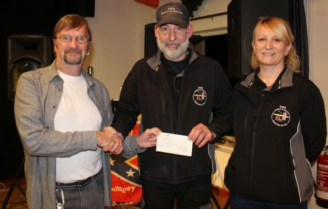 DONATION: Volunteers from BARB Search and Rescue are handed the cheque from a member of the Blue Ridge Runners