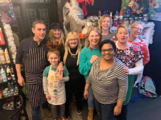 HELPING THE HOMELESS: Staff from The Crafty Teacup Creative Centre with homeless people at their event in December 2019