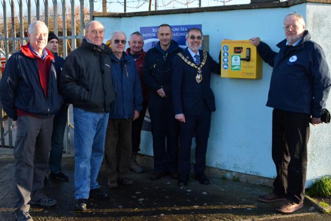 LIFESAVING KIT: Members of Burnham-on-Sea Sailing Club unveil the new defibrillator with Mayor of Burnham-on-Sea Cllr Andy Brewer