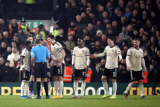 Referee Craig Pawson was surrounded by Manchester United's players