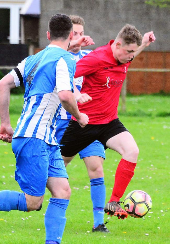 ON TARGET: Burnham's Ryan Stiles (red kit). Pic: Steve Richardson