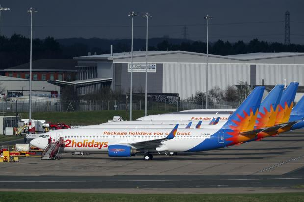 Burnham and Highbridge Weekly News: AIRLINE: Several Jet2 planes have been parked up at Birmingham Airport during the pandemic. Picture: Steve Parsons/PA
