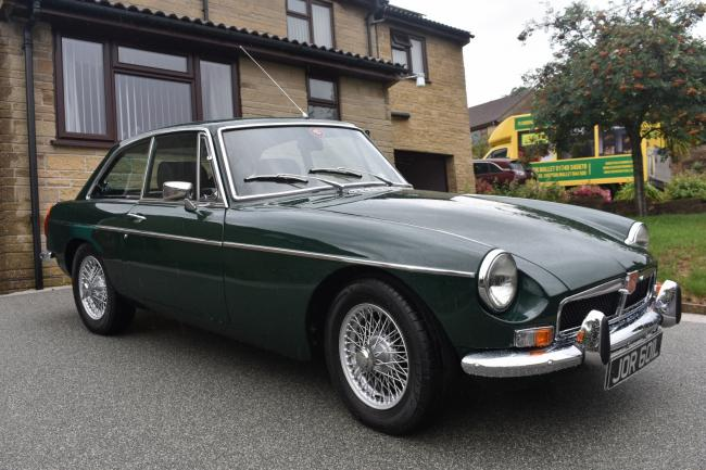 CLASSIC: A 1972 MG BGT, fully restored with a new Heritage body shell in British Racing Green with overdrive, wire wheels and a black leather interior