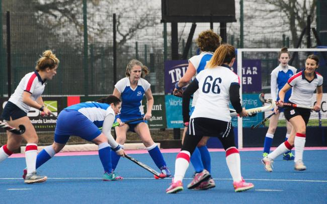 PLAYER OF THE MATCH: Burnham's Caroline Hunt (pictured centre, in blue kit)