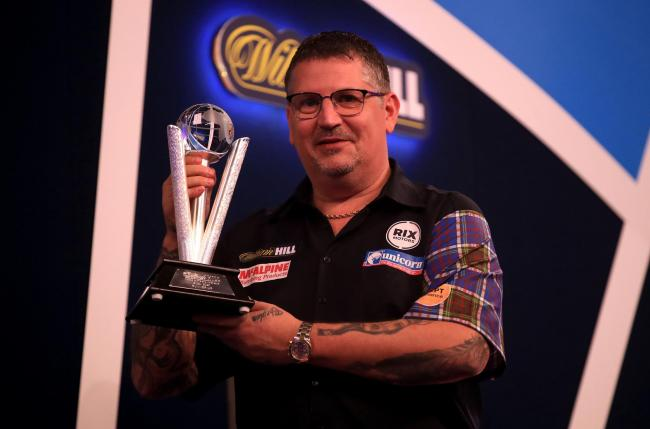 JUST SHORT: Gary Anderson with his runner-up trophy after losing the final against Gerwyn Price (pic: PA Wire)