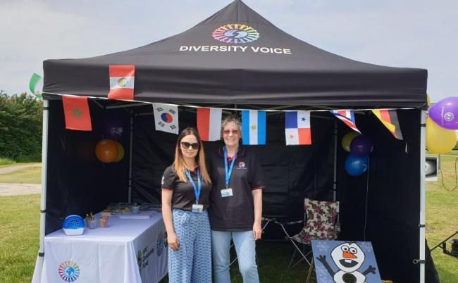 Staff at Diversity Voice attend an event (pre-coronavirus) to promote intercultural understanding