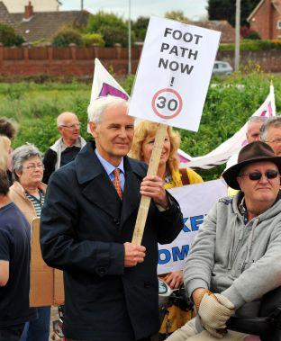 BANNER-WIELDING campaigners issued a fresh plea to highways bosses for safety measures on a vital tourist route between Berrow and Brean.