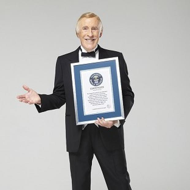 Sir Bruce Forsyth has received a Guinness World Record