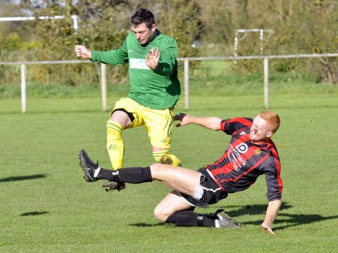 Goalscorer Josh White slides in to cut off a Stockwood Green move. PHOTO: Mike Lang