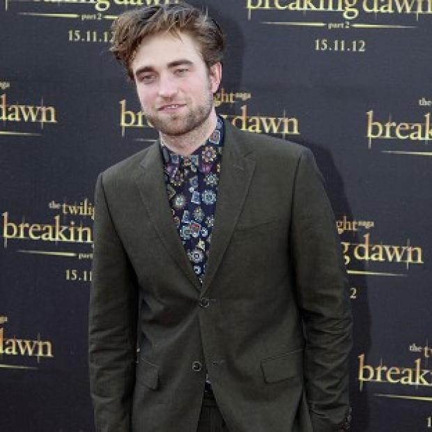 Robert Pattinson reckons the sex scenes in the latest Twilight movie were awkward to film