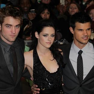 Taylor Lautner says he and his fellow Twilight castmates haven't been changed by their fame
