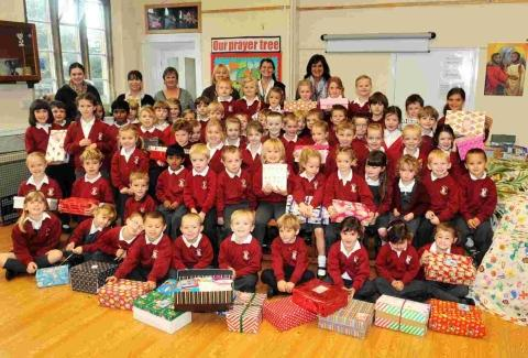Pupils prepare to send gifts to underprivileged children around the world.