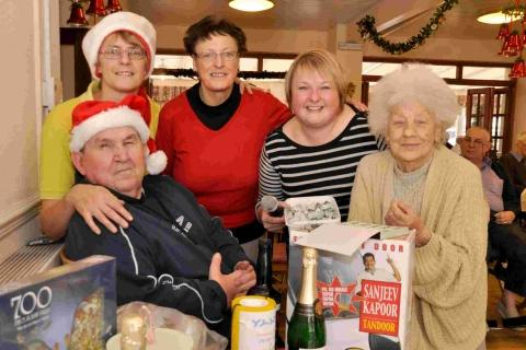 Resident Brian Webb, Angela Lock, Margaret Main-Read, Home manager Vicki Mitchell and Mary Skinner man the raffle.