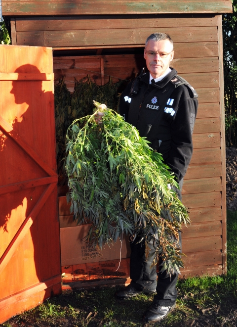 Sgt Ian Kennett at the scene of the drugs raid in Highbridge last Friday (January 11). Photo: Jeff Searle.