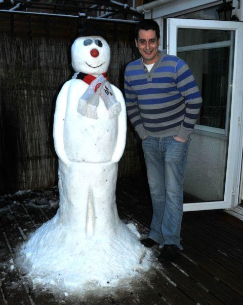 Burnham and Highbridge Weekly News: Daniel Searle with Snowy in Bridgwater, Somerset. January 23, 2013.