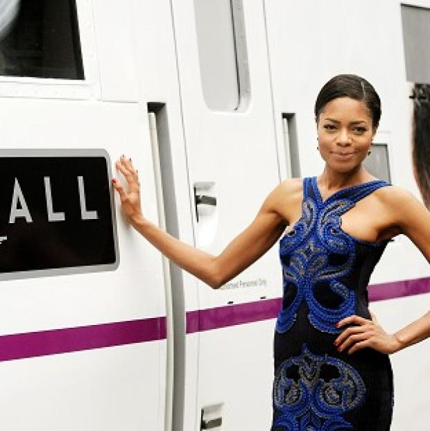 Naomie Harris, who starred in the latest James Bond film Skyfall, stands next to an East Coast train named after the movie