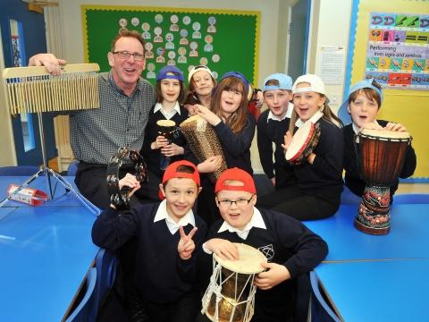 Pete Stevenson (AKA Pete the Poet) with children from St Andrew's Junior School using rap music and drama to learn about bullying. Photo: Jeff Searle.
