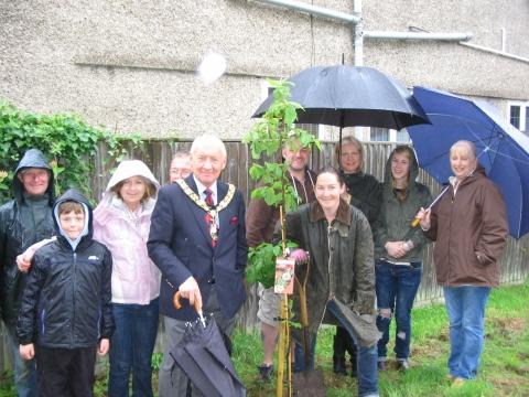 Burnham Mayor Ken Smout with Sarah Milner Simonds planting a new 'Jubilee' tree with residents. Photo: submitted.