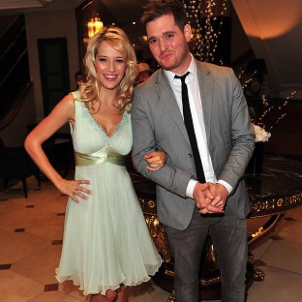 Michael Buble and wife Luisana Lopilato are expecting their first child in August
