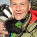 Chris Packham with a badger at Secret World.