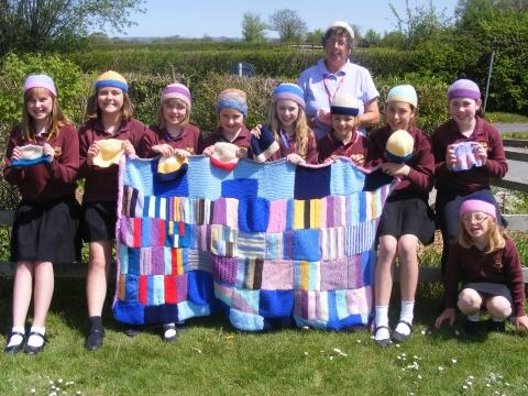 Jenna, Imogen, Jennifer, Megan, Sophie, Megan, Maya, Romey and Mia with the knitted items. PHOTO: submitted.
