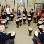 Children enjoying an African drumming workshop led by Burnham Infants teacher, David Quint.
