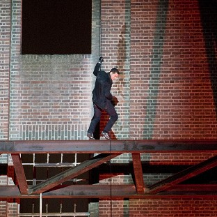 Bear Grylls abseils down a side of Battersea Power Station