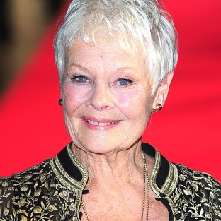 Dame Judi Dench has recalled flashing her bottom at Harvey Weistein in a Hollywood restaurant
