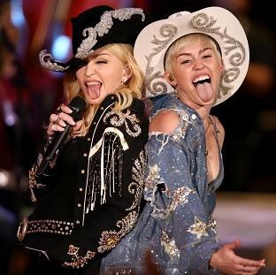 Miley Cyrus performs with Madonna for MTV Tuesday Jan. 28, 2014. The 21-year-old pop star and the 55-year-old Queen of Pop grinded and grabbed each other as they performed Cyrus' hit