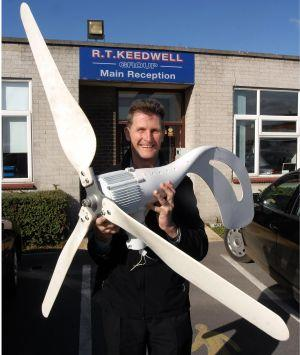 Coemi UK managing director, Paul Young, demonstrates the small wind turbines on sale in Burnham.