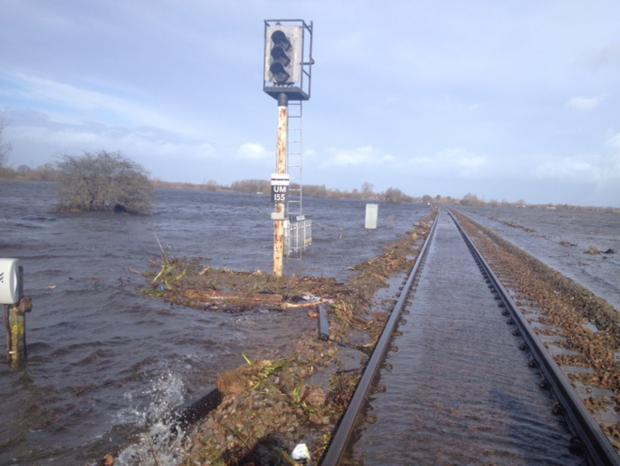 Burnham and Highbridge Weekly News: FLOODED: The railway line between Taunton and Bridgwater - a replacement bus service is in place.