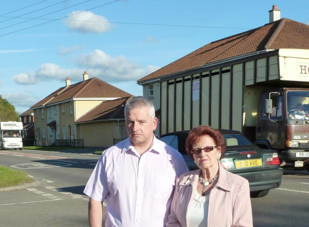 Lights for Life charity chairman, David Maund, with founder Pat Ireland by the busy A38, Rooksbridge.