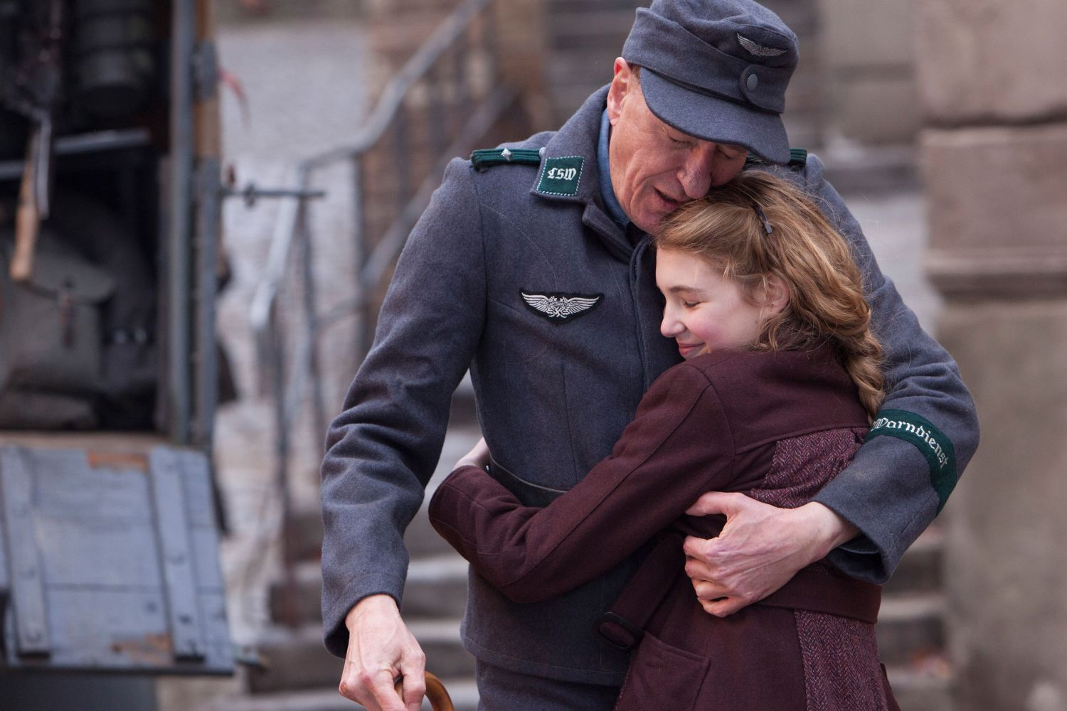 LIESEL (Sophie Nélisse) embraces her foster father Hans (Geoffrey Rush) in