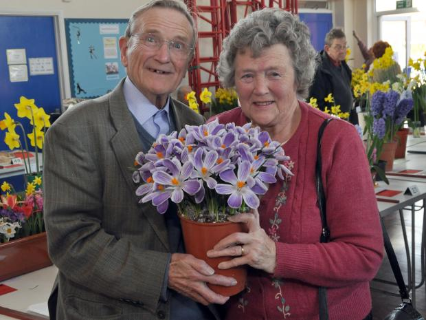 Alan Burnett and his wife Angela with their home grown flowers.