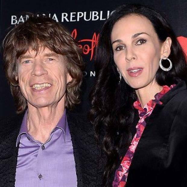 Burnham and Highbridge Weekly News: Sir Mick Jagger with girlfriend L'Wren Scott, who has been found dead