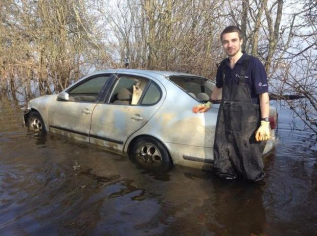 Burnham and Highbridge Weekly News: Hubert with his car once the waters receded.