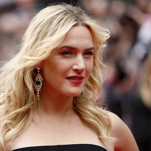Kate Winslet has said it was great to be pregnant on the set of Divergent
