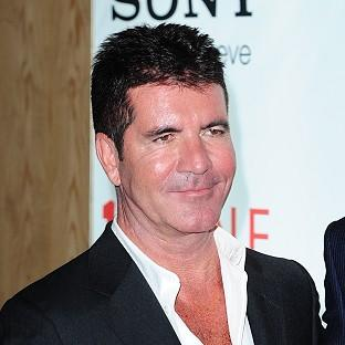 Simon Cowell says there couldn't be two 'head judges' on