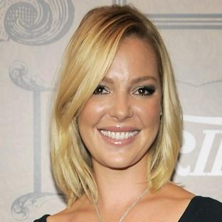Actress Katherine Heigl is suing Duane Reade, saying the company is using a picture of her leaving one of its pharmacies in its promotional materials (Invision/AP)
