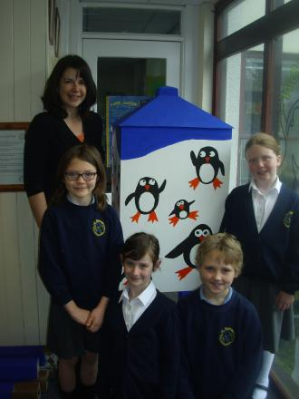 Isabelle, Emily, Rohan and Kenzie with their painted lighthouse and teacher Mrs Cavaciuiti