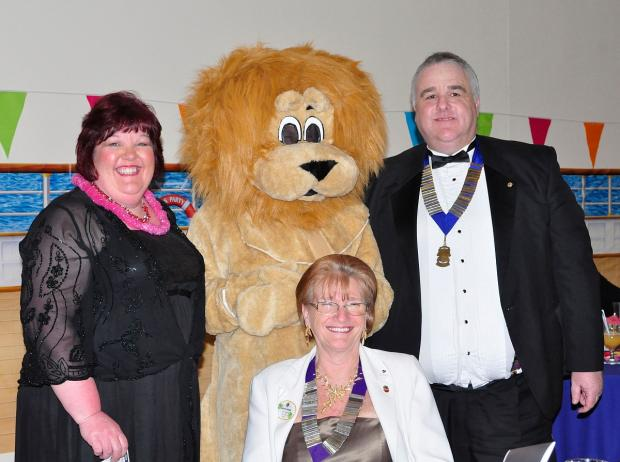 Sue and Les Barber with Rufus the Lion and (front) Lions district governor