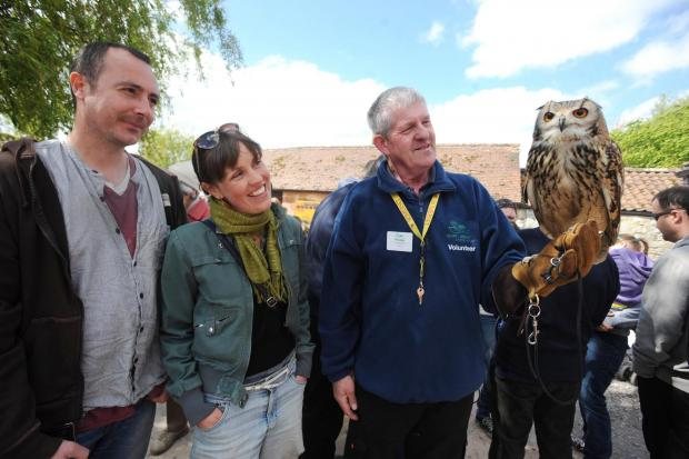 James Ealy, Eleanor Carr and Greg Kellaway with Mumbles the Bengal Owl